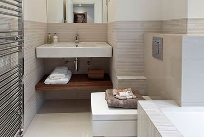 Cheap and inexpensive bathroom design themes and decorating ideas small room with striped wall tiles and sink